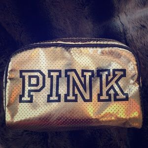 Gold perforated faux leather cosmetic bag by Pink